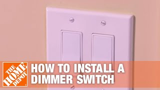 Someone adjusting a dimmer switch in the kitchen.