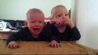 Babies crying. Twins and a toothbrush