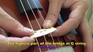How to set up a violin bridge and tune a violin with a clip violin tuner