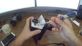 How to remove the front plate on your Polaroid One step rainbow.