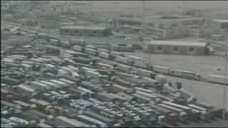 Stranded lorries at the Saudi border width=