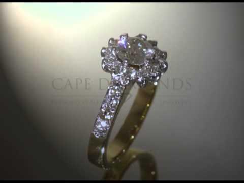 Organic ring design,round diamonds,flower shape,smaller diamonds on side,gold,engagement ring