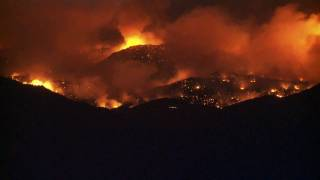 time lapse night shot boulder forest fire