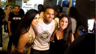 Chris Brown greets fan while arriving at Bootsy Bellows in West Hollywood, CA