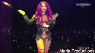Sasha Banks enters the arena with Paige's theme song