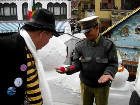 Bumm doing magic at Boudha Stupa in Kathmandu Nepal
