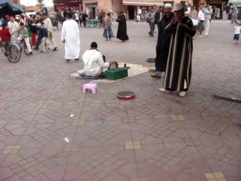 Snake charmers and the main square in Marrakesh