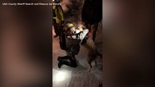 Woman's emotional reunion with dog rescued from 40-foot hole