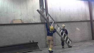 Lowering and stowing an extension ladder
