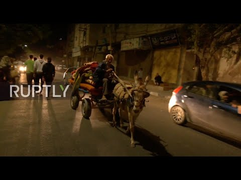 State of Palestine: Families flee Gaza neighbourhood in fear of attacks photo