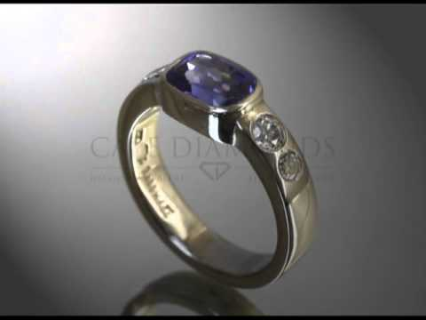 Simple side stone ring,oval Tanzanite ,2 round white diamonds each side,bold band,engagement ring
