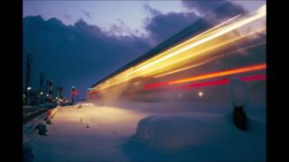 Passing Train on a Snowy Night in Japan