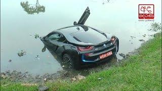 Unregistered super luxury car plunges into Diyawanna Oya