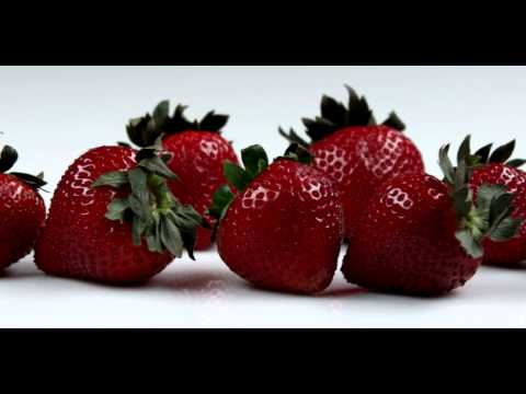 Royalty Free Stock Footage of Close up slow pan across strawberries.