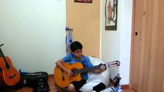 Luk Montti playing the guitar.mp4