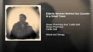 Elderly Woman Behind the Counter in a Small Town