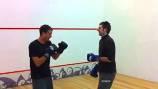 Fight on squash court