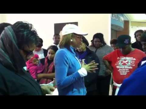 Dr. Dorinda Clark Cole praying at the Prayer Walk