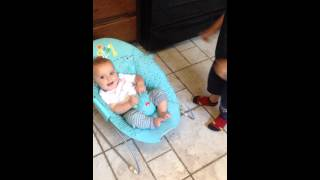 Baby brother laughing at older brother