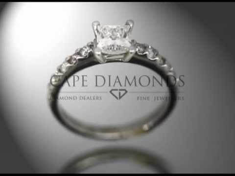Princess cut,diamond,4 claws,6 small round diamonds on each side,platinum,engagement ring