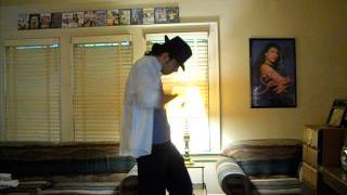 "Michael Jackson impersonator dancing to ""Billie Jean"""