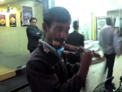 Guy playing flute in dhaka bangladesh