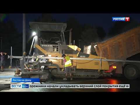 На новом мосту Малиновского дорожники начали укладывать финишное покрытие
