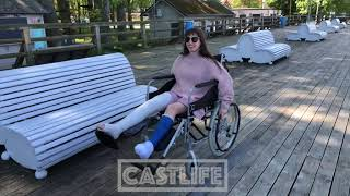 Sara with two broken legs on wheelchair - have fun in the vacation