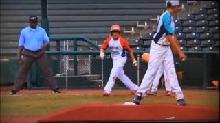 Smart 10-year-old pitcher picks off runner at 1st base.