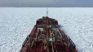 Ship moving through ice (Frozen Sea) in North Atlantic ocean