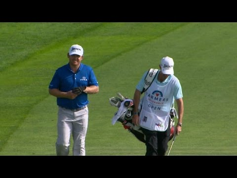 J.B. Holmes pitches in for birdie at Farmers