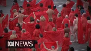 Spencer Tunick stages Melbourne nude photo shoot on top of a supermarket