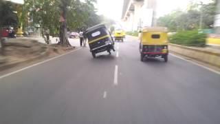 Auto rickshaw wheelie in Iskon road