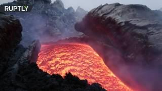 Rivers of hot lava flow onto slopes of Mount Etna after eruption