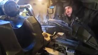 Inside a russian tank/artillery that is firing