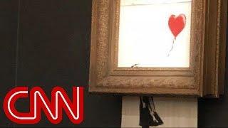 Watch Banksy's $1.4 million painting 'self-destruct'