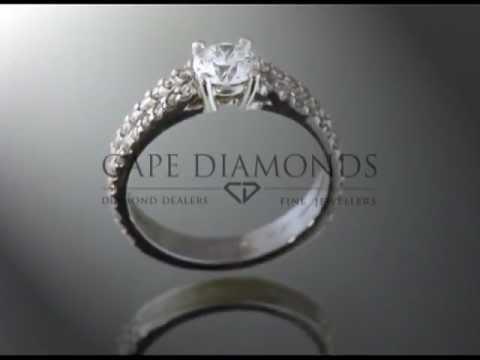 Split band ring,round diamond,small round diamonds around the band,engagement ring