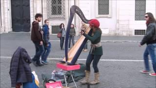Street artist Harpist plays Yann Tiersen Comptine d'un autre été (cover)
