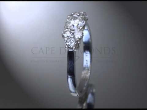 Complex stone ring,round diamond,three smaller round diamonds each side,engagement ring