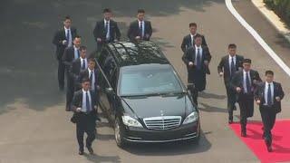 Kim Jong Un's Elite North Korean Bodyguard Squad Turns Heads at Summit width=