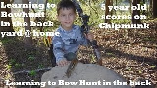 5 yr old takes Chipmunk with bow and arrow youth learning  to hunt young, practice