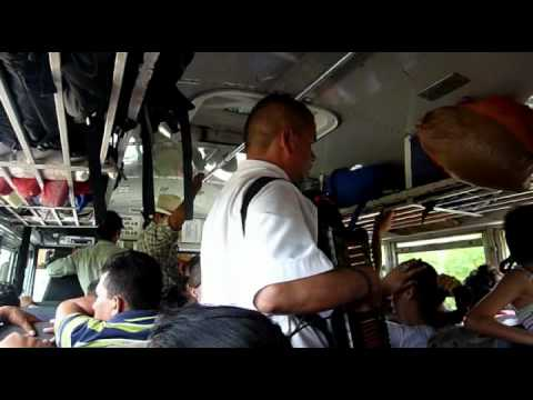 Blind man playing accordion and singing on a Chicken Bus