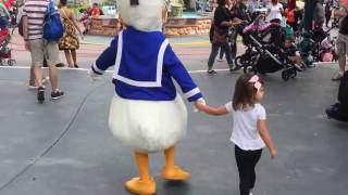 Frankie meeting/walking with Donald Duck in Toontown @ Disneyland