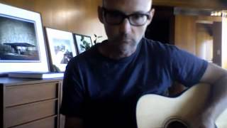 Moby in his studio playing guitar