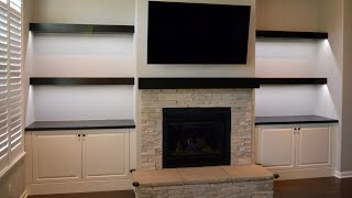 Custom built in cabinets, floating shelves and fireplace mantel