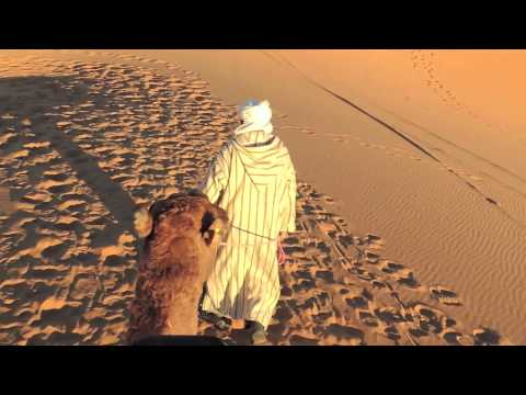 Chuck and Rolfe Ride (The Pope) Into The Sunset in the Sahara Dessert at Merzouga, Morocco