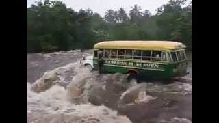 Bus with passengers swept away in flood waters