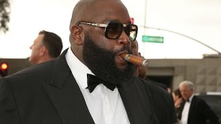 Rick Ross Buys back the block, begins with Checkers restaurant