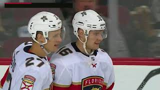 Aleksander Barkov tips long shot past Rittich