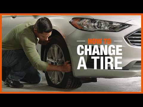 A video reveals the steps for changing a flat tire.